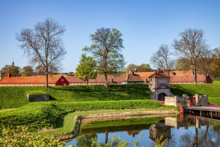 Photo for Scenic view of calm pond, bridge and old historical houses between trees in copenhagen, denmark - Royalty Free Image