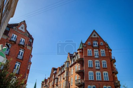 low angle view of buildings against blue sky, copenhagen, denmark