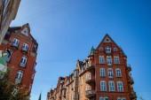 "Постер, картина, фотообои ""низкий угол зрения зданий против голубого неба, Копенгаген, Дания"""