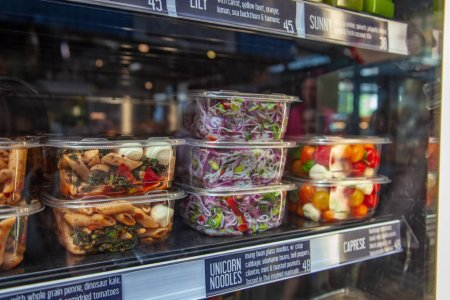 various types of salad in plastic containers