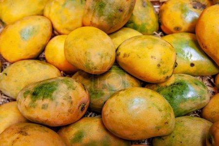 full frame image of pile of yellow mangoes