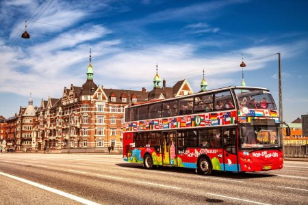 Photo for COPENHAGEN, DENMARK - MAY 6, 2018: Sightseeing bus with tourists on street in Copenhagen, Denmark - Royalty Free Image
