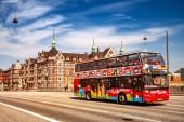 COPENHAGEN, DENMARK - MAY 6, 2018: Sightseeing bus with tourists on street in Copenhagen, Denmark