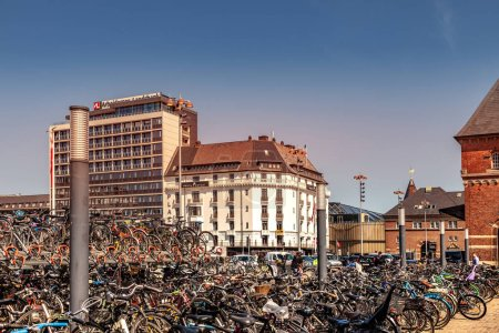 COPENHAGEN, DENMARK - MAY 6, 2018: bicycles of parking lot and cityscape behind