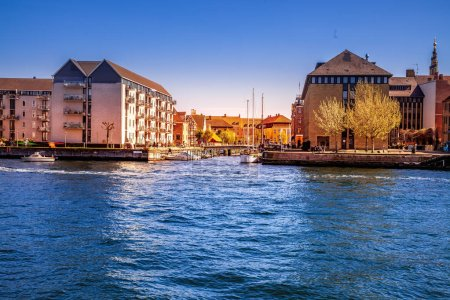 Photo for COPENHAGEN, DENMARK - MAY 6, 2018: scenic view of cityscape and river with boats - Royalty Free Image