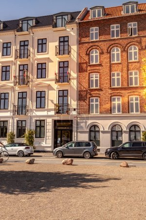 COPENHAGEN, DENMARK - MAY 6, 2018: parked cars on street in front of buildings