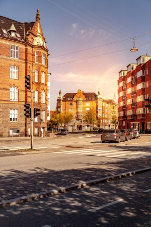 Photo for COPENHAGEN, DENMARK - MAY 6, 2018: cityscape with buildings, street and cars - Royalty Free Image