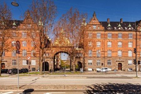 COPENHAGEN, DENMARK - MAY 6, 2018: cityscape with street and cars in front of buildings in Copenhagen, Denmark