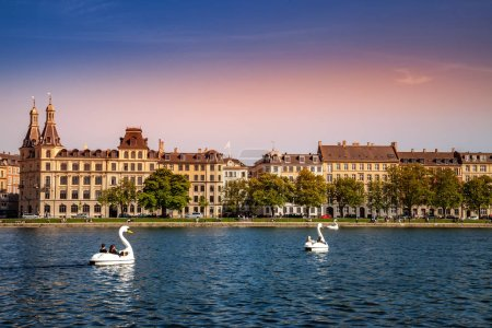 COPENHAGEN, DENMARK - MAY 6, 2018: tourists riding on catamarans shaped of swans in river