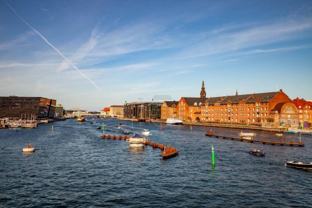 COPENHAGEN, DENMARK - MAY 6, 2018: aerial view of cityscape with river and boats