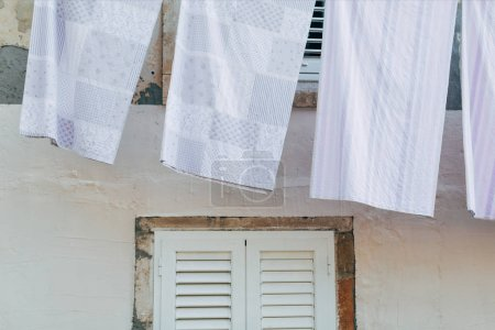 close up view of laundry against light building wall in Dubrovnik, Croatia