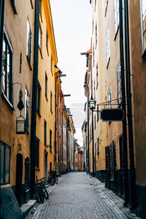 Photo for Urban scene with narrow street and beautiful colorful buildings in old town of Stockholm, Sweden - Royalty Free Image