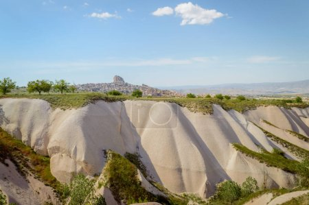 scenic view of valley and slopes with cityscape behind, Cappadocia, Turkey