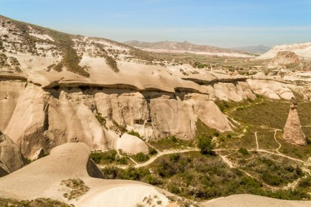 scenic view of slopes in valley and mountains in Cappadocia, Turkey