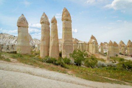 scenic view of fairy chimneys and mountains in valley, Cappadocia, Turkey