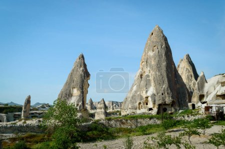 front view of dwellings in stone formations in valley of Cappadocia, Turkey