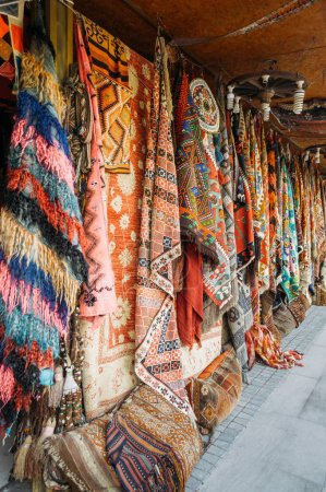 close up view of different colorful carpets at market in Cappadocia, Turkey