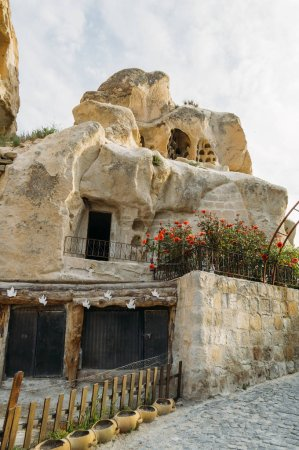 low angle view of dwelling in stone formation in Cappadocia, Turkey