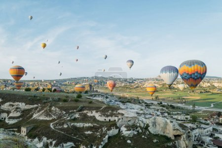 front view of hot air balloons flying over cityscape, Cappadocia, Turkey