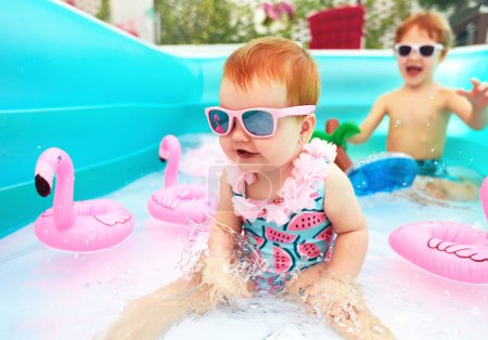 Photo for Cute happy baby girl having fun in kid pool, summer vacation - Royalty Free Image