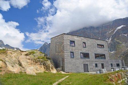 modern Annenhutte mountain refuge at head of Lotschtal in Swiss Bernese Alps.