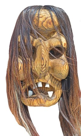 Witch mask carved from wood