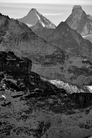 Photo for Monochrome of the Obergabelhorn (left) and Matterhorn viewed from the North in the Southern Swiss Alps between Zinal and Zermatt. - Royalty Free Image