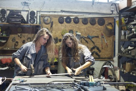 Photo for Two young women working in workshop - Royalty Free Image