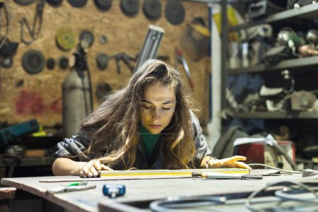 Photo for Young woman working in a workshop - Royalty Free Image