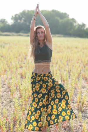 Photo for Young woman doing yoga outdoors - Royalty Free Image