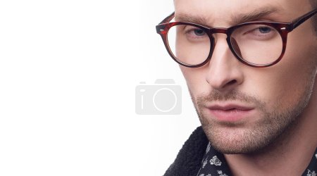 Photo for Young bearded man in black jacket, pattern shirt and eyeglasses isolated on white background with copy space - Royalty Free Image