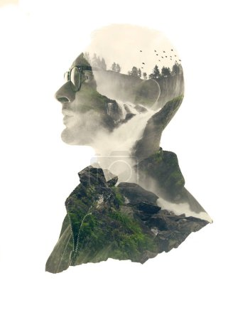 Double exposure silhouette portrait of thoughtful man with green forest landscape in water reflection.