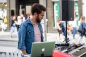 London, UK, July, 2019. DJ playing at Summer Streets event, Regent Street