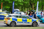 Bedford, Bedfordshire, UK June 2 2019.Police Vehicle responds to an emergency on a city center street during special event