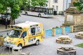 Castletown, Isle of Man, June 15, 2019. Looking from Castle Rushen, into Castletowns Market Square with Ice cream van