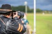 Photographer shooting at an air show.Race Day at Shuttleworth.