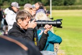 OLD WARDEN, BEDFORDSHIRE, UK, OCTOBER 6, 2019. Photographer shooting at an air show.Race Day at Shuttleworth.