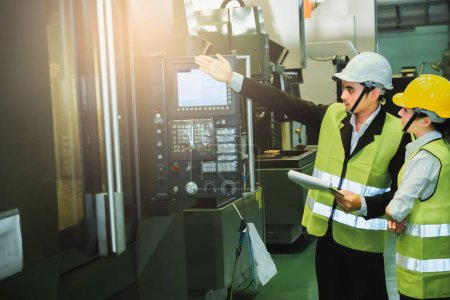 Photo for Asian female engineer factory inspection with man business engineer in industry She wears a helmet female working metalwork control in industrial In a plastic factory for car - Royalty Free Image