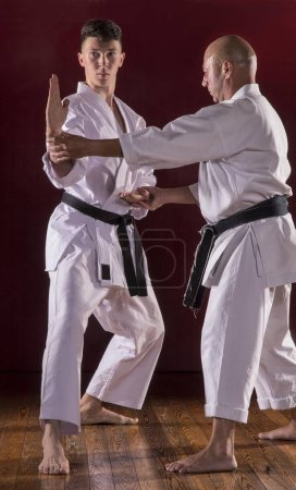 Photo for Martial karate instructor teach to a kid. - Royalty Free Image