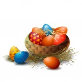 Easter eggs in a wicker basket on a white background Element for greeting card or banner for Easter
