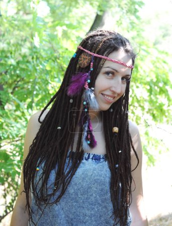 Happy smiling woman with dreadlocks portrait, hippie, indie, boho style