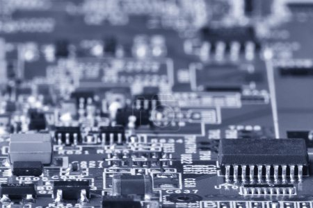 Printed circuit board close up for background Microchips and other components Small depth of field Toned image
