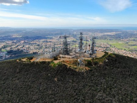 Photo for Aerial view of telecommunication antennas on the top of Black Mountain in Carmel Valley, SD, California, USA.  Television, radio and communications antenna with numerous transmitters, Technology. - Royalty Free Image
