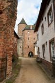 Bertradaburg or Burg Muerlenbach, a ruined hill castle at Murlenbach, Rhineland-Palatinate, Germany, exterior street partial view.