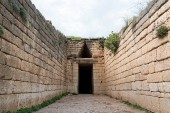The entrance of the Tholos Tomb of Agamemnon at the archaeological site of Mycenae in Peloponnese, Greece
