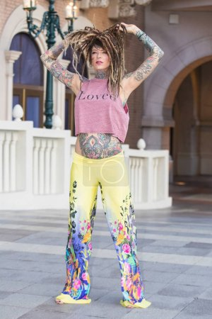 Beautiful hippie woman with tattoos and dreadlocks