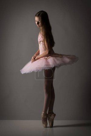 Young ballet dancer in pink tutu