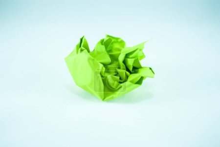 Crumpled green paper on light background