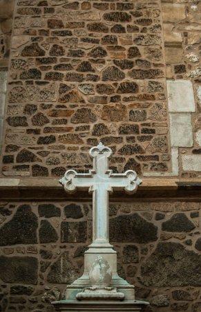 Catholic cross near the walls