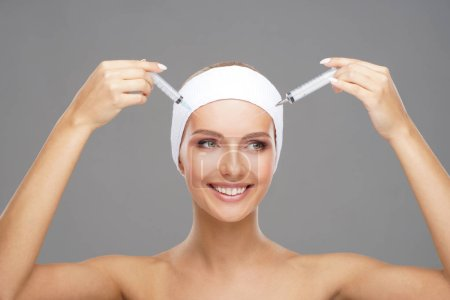 Beauty injection in a face of a young woman. Plastic surgery, skin lifting and aesthetic medicine concept.
